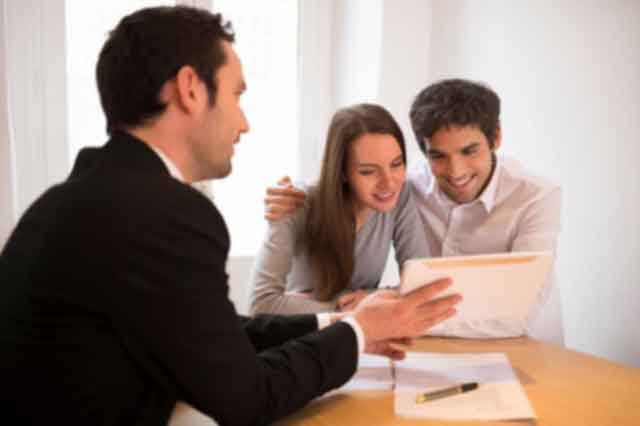 Young Couple meeting Realtor or Lender