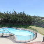 Yard with pool showing view