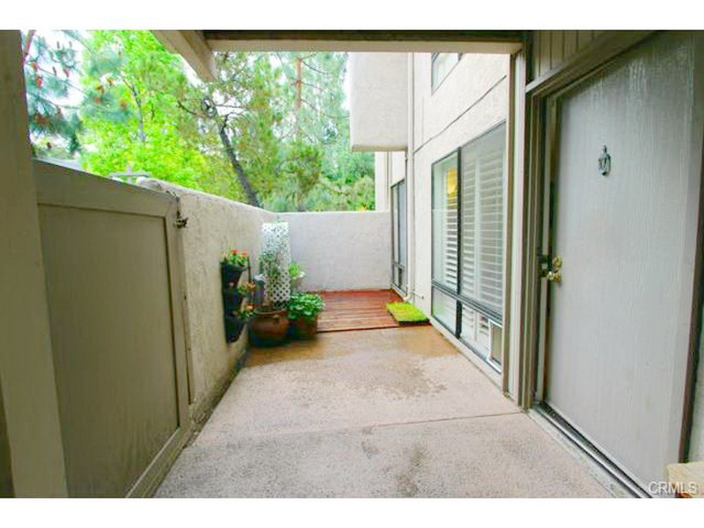 Patio is Partially Covered and is Accessible Both via Front Door at 3000 Asscoated Rd. Unit 53