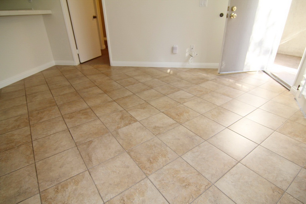 Tile Flooring in Kitchen and Livingroom at 3000 Asscoated Rd. Unit 53