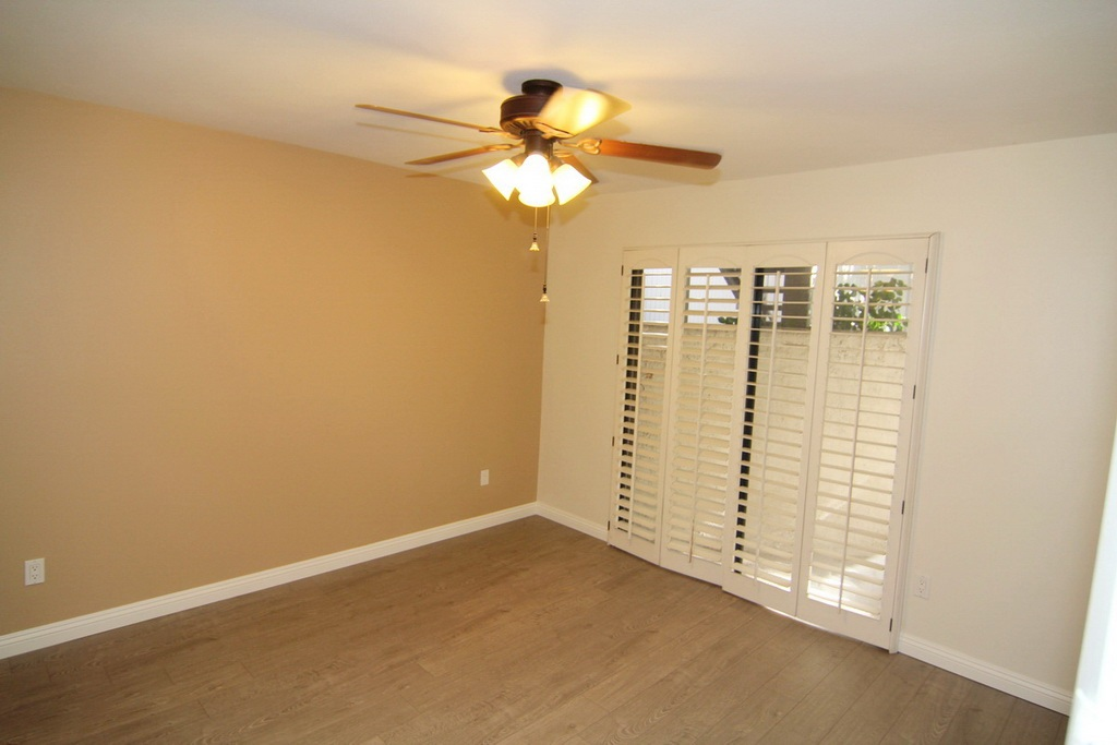 Bedroom with Ceiling Fan and Patio Access at 3000 Asscoated Rd. Unit 53